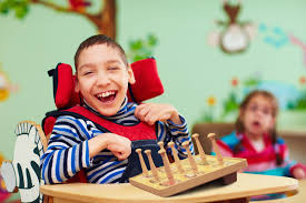a boy with cerebral palsy plays chess